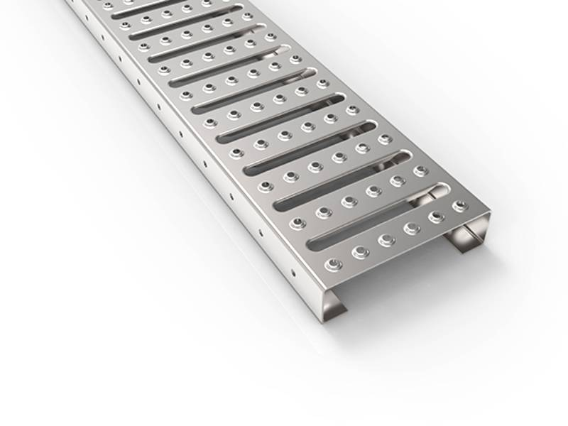 Interlocking safety grating with serrated surface.