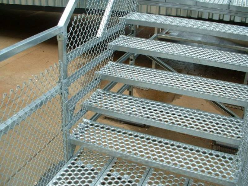 Five pieces of stair treads and the floor under it are made of O-grip safety grating.