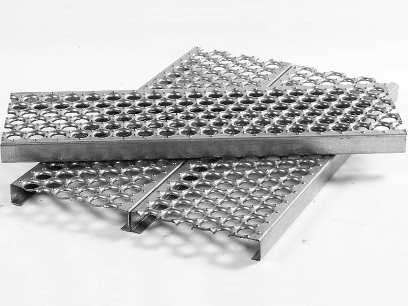 Two safety grating placed side by side, and another safety grating placed on them.