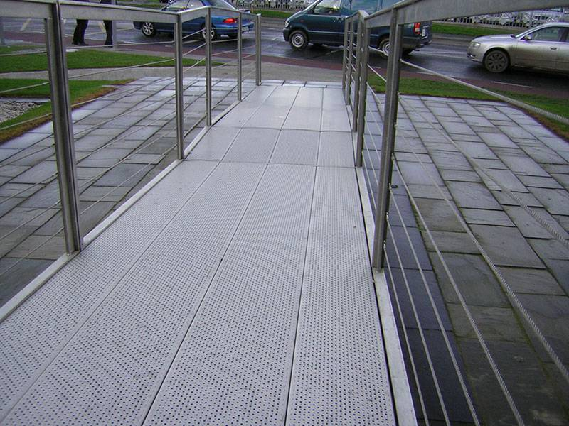 Traction-Grip safety grating is used as slope beside a road.
