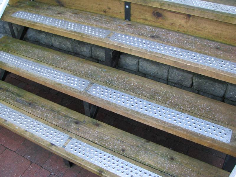Traction-Grip safety grating installed on existing surface of stair treads for slip-resistance.