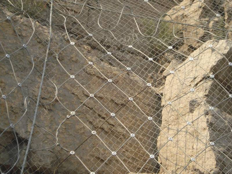 Steel wire rope net with chain link mesh for active soil protection.