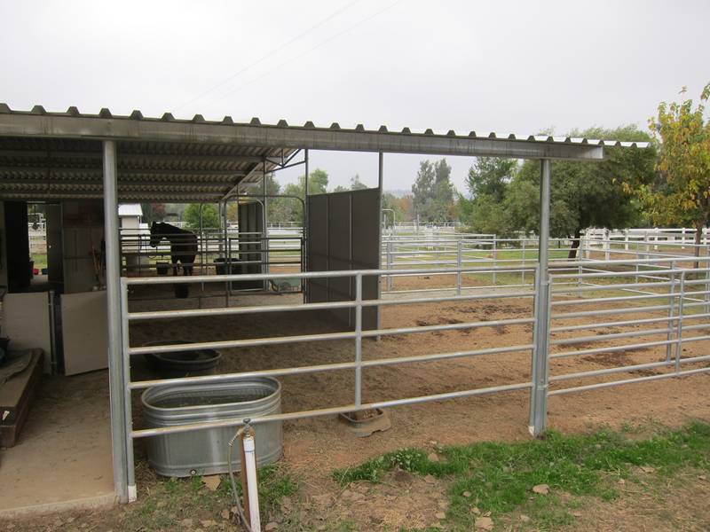 Galvanized horse fence installed for stable fencing.