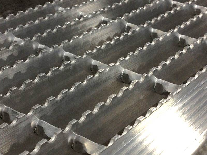 There is a swage locked grating with high strength and the serrated surface for anti-slide effect.