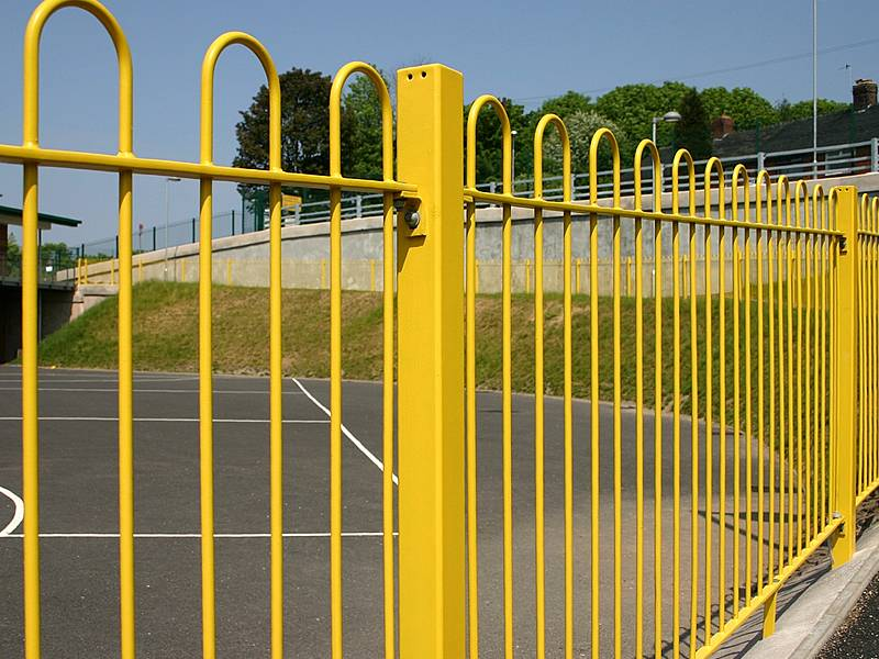 Yellow bow top fencing for roadside protection, it is attractive yet protective.