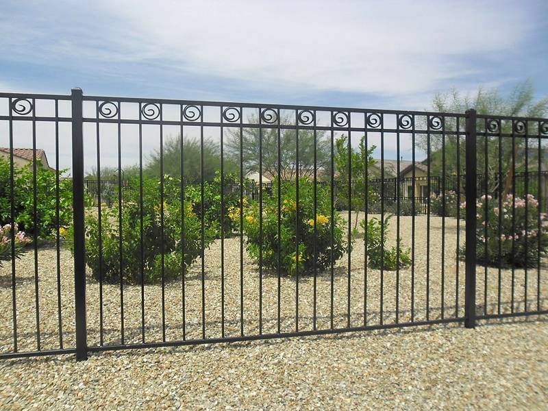 Wrought iron fence without finial around the residential area.