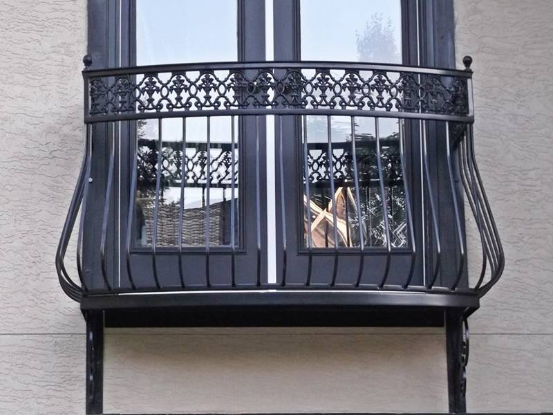 Wrought iron enclosure outside the glass window.