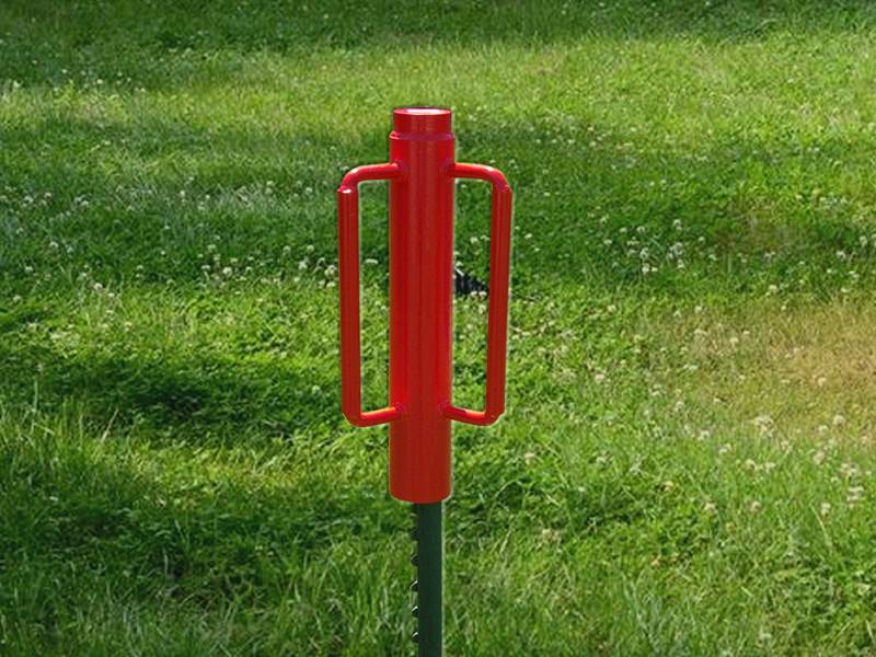 A red post driver used for T studded post installation.