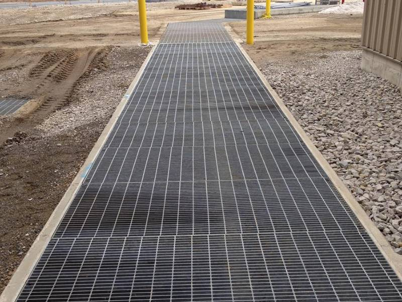 Steel bar grating used as walkway at the building base.