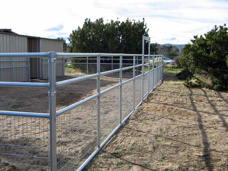 Galvanized horse fence with welded wire mesh bottom for storeroom fencing.