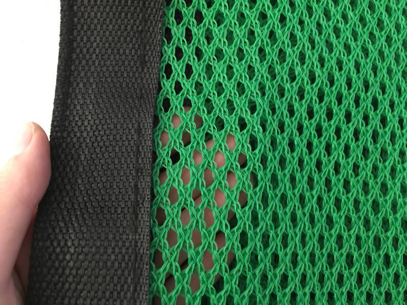 The green windbreak netting with reinforced edge shown.