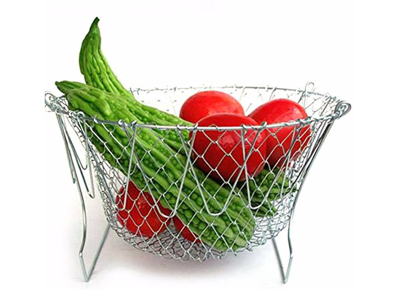 Semicircle metal tray contains fresh vegetable.