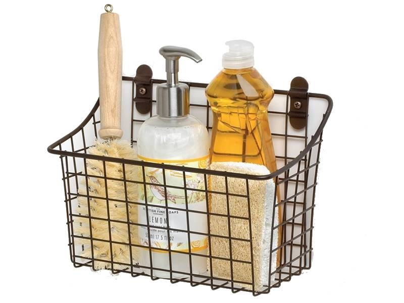 Storage basket stick on the wall and holds shampoo, towel and brush.