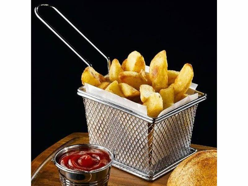 A square fry basket holds french fires on the table.