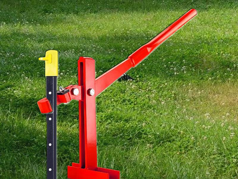 A red post puller used for Y fence post uninstalling.