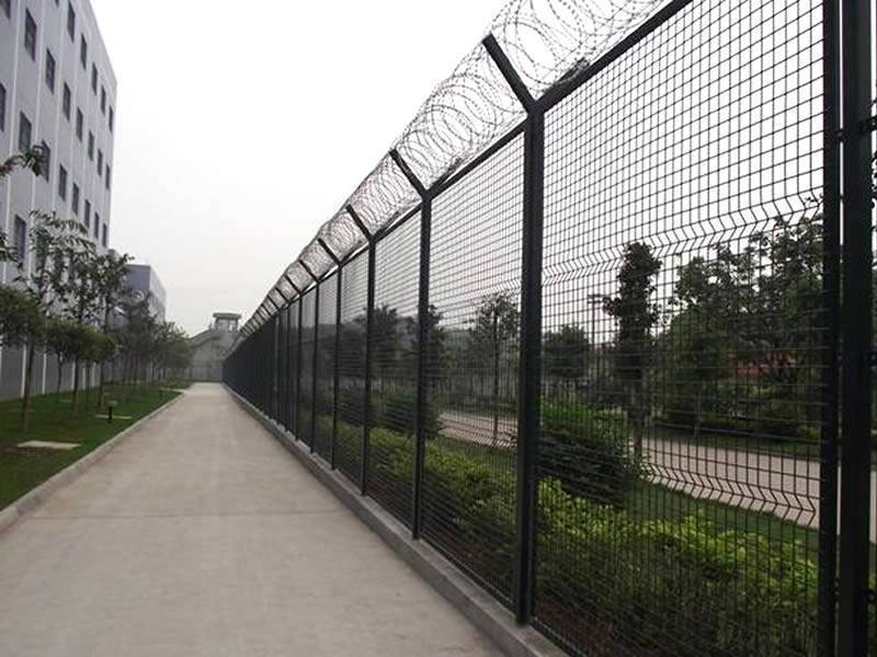 Razor wire is installed on the welded wire fence in a governmental agency.