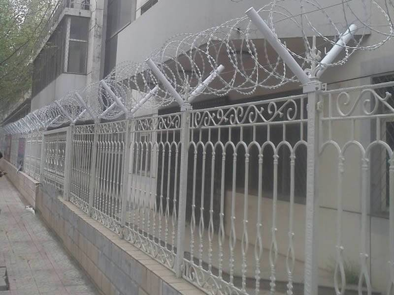 In one residential area, the razor wire is installed on the Y post of the wrought iron fence.